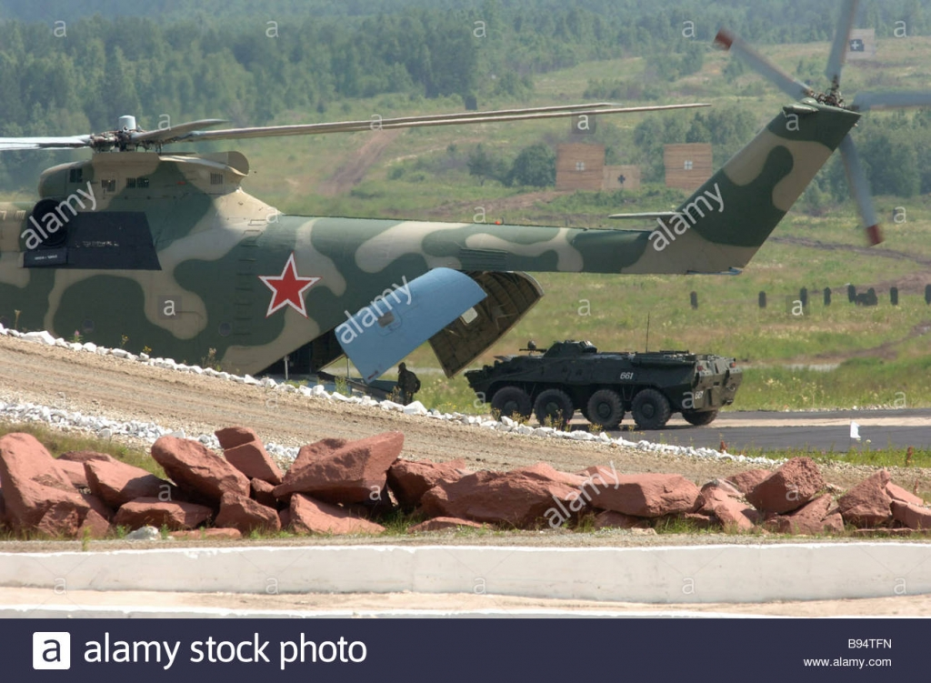 a-mi-26-helicopter-performing-a-demonstration-landing-with-an-apc-B94TFN.jpg
